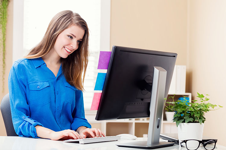 young woman working in her home office
