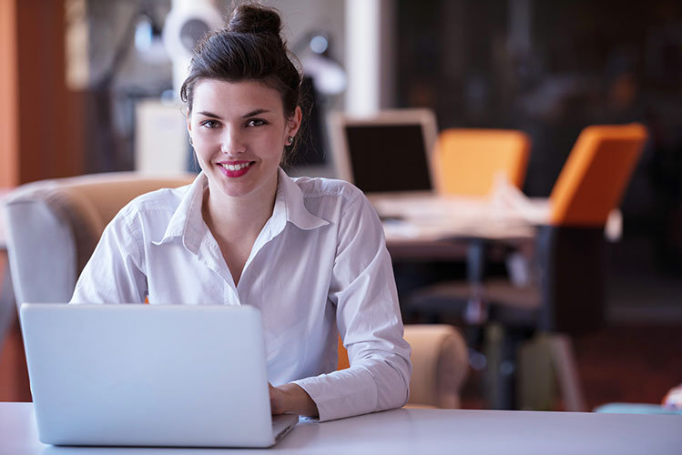 young woman working in shared workspace
